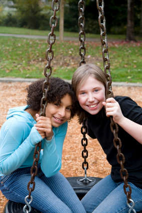 Girls on Swing istock